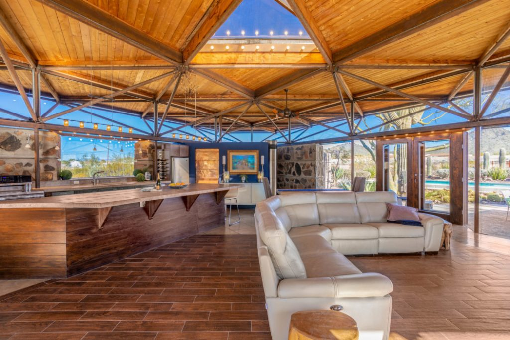 Great design - expansive living room constructed of metal, glass and wood.
