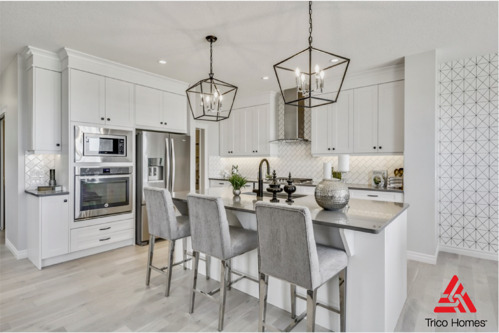 Beautiful white kitchen with island n Trico Home.